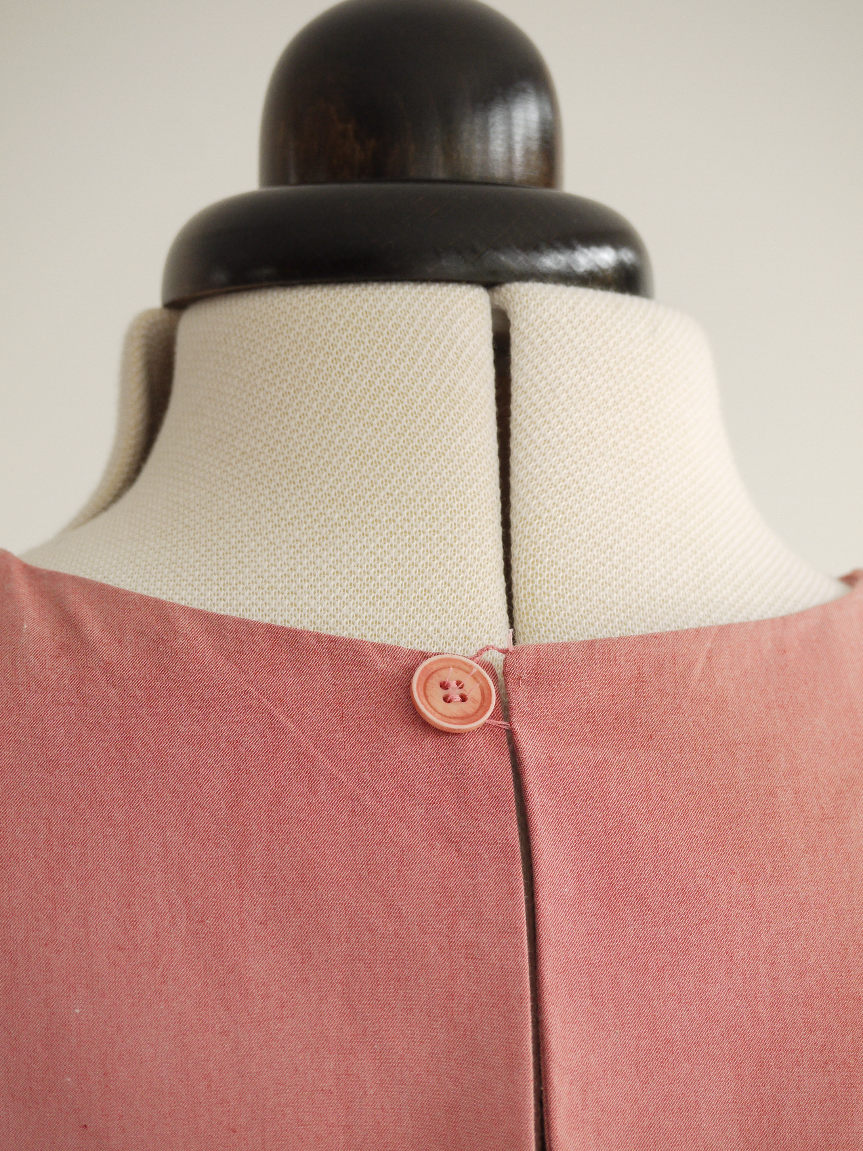 Neck opening with button and button loop