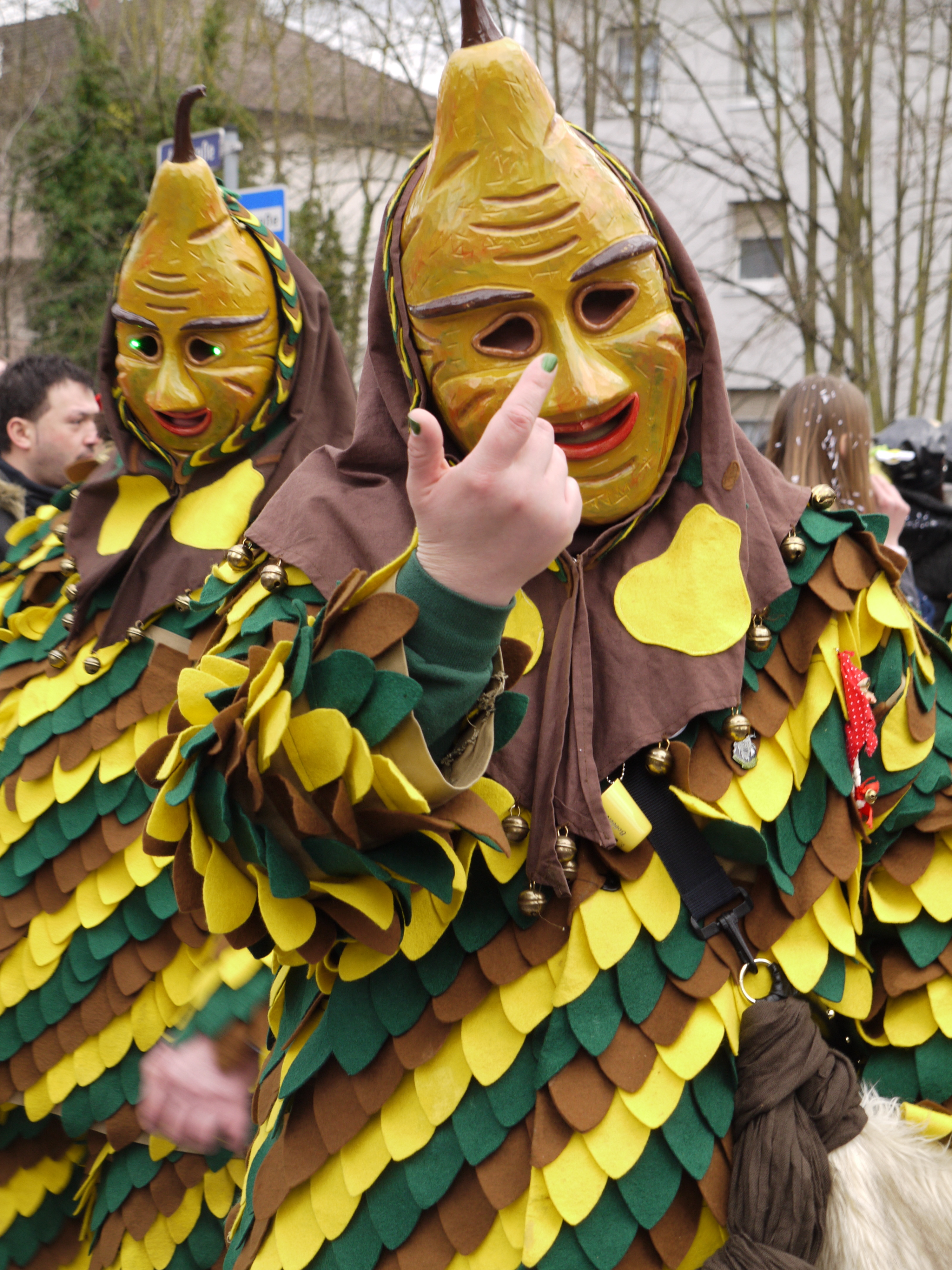 Hand carved wooden masks and hand-made carnival costumes
