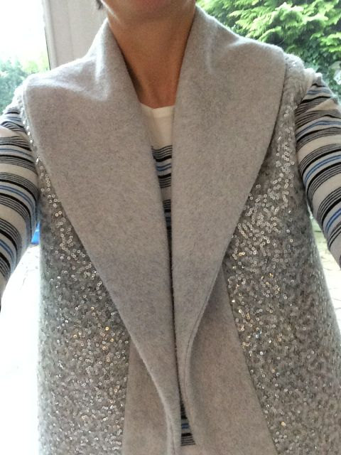 Tala vest by Named Clothing in organic cotton fleece and sequinned wool coating.