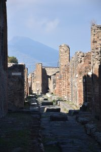Mount Vesuvius looming over the ruins of Roman town Pompeii, Italy